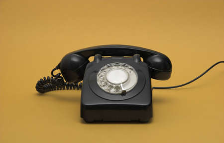 device disc: Old phone  in a yellow background Stock Photo