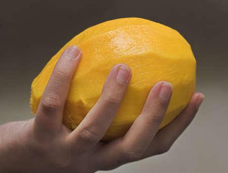 Ripe mango fruit on the hand photo