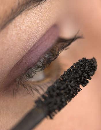 glitter gloss: Closeup of a young beauty applying makeup.