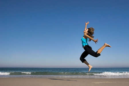 woman jumping in the beach Stock Photo - 404743