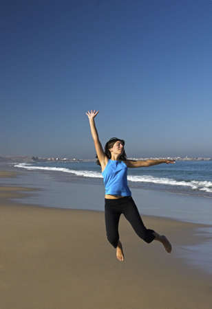 woman jumping in the beach Stock Photo - 404744