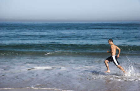 Man doing exercise in the beach Stock Photo - 404742