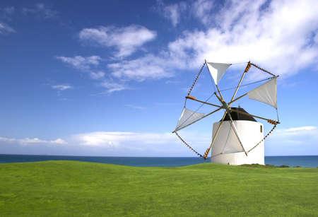 greeen: Windmill in a beautiful greeen field Stock Photo