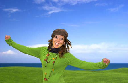 Happy woman in a green fiels photo