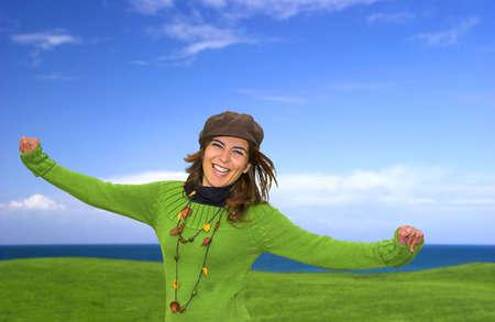 Happy woman in a green fiels photo