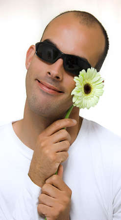 Man with a beautiful yellow flower Stock Photo - 407906