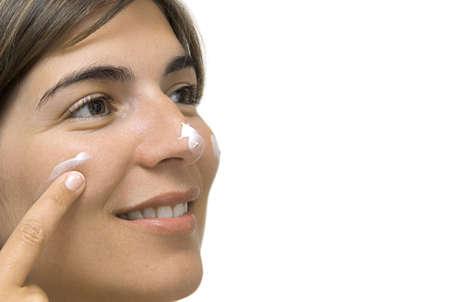 Woman applying make-up photo