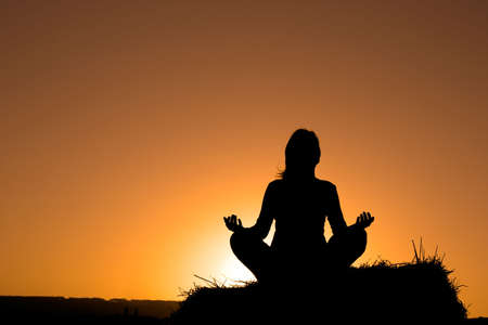 Woman silhouette making yoga Stock Photo - 430171