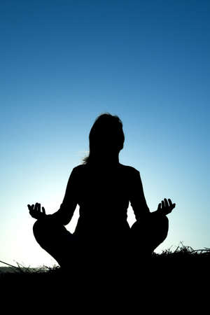 Woman silhouette making yoga Stock Photo - 430158