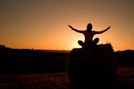 Woman silhouette making yoga photo