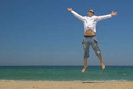 Man jumping on the beach Stock Photo - 433221