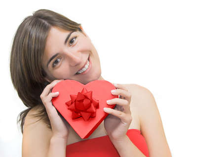 Beautiful woman with a heart gift on is hands photo