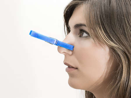 Woman with clothespin in the nose photo