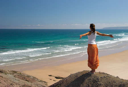 Woman feeling the wind with open arms photo