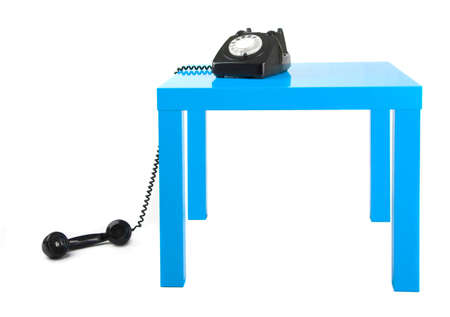 Vintage phone on a blue table photo