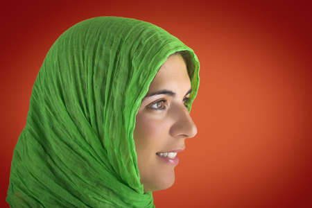 Beautiful woman portrait in a red background with a green handkerchiefs Stock Photo - 504425