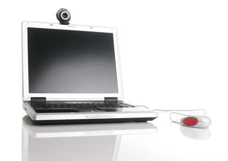 Laptop with a webcam over the table with reflection photo