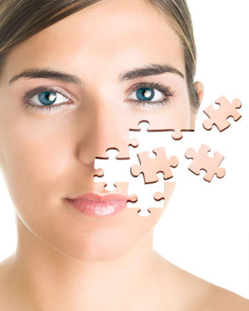 Face of a beautiful young woman with a puzzle collage. photo