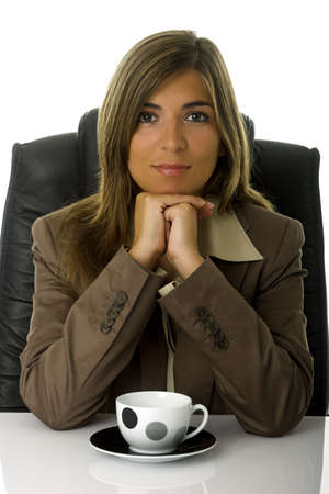 casua: Young and beautiful business woman drinking a coffee in the office