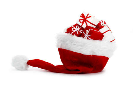 A red santa hat with gifts isolated on white background photo