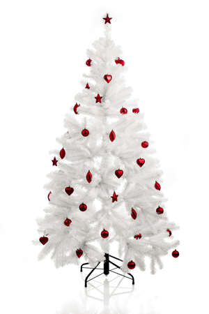 Christmas white tree with red ornaments Stock Photo