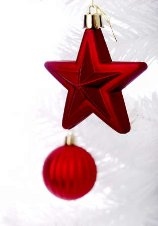 Christmas ornaments hanging from a white tree photo