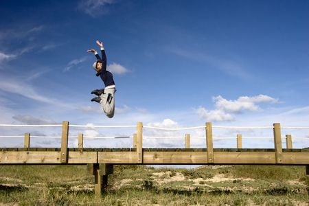 Young woman jumping for fun in a beautiful day photo