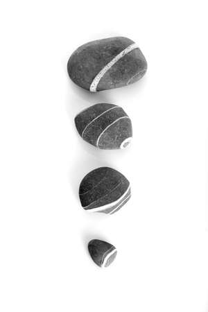 Four stones with diferent sizes isolated on a white background Stock Photo - 869585