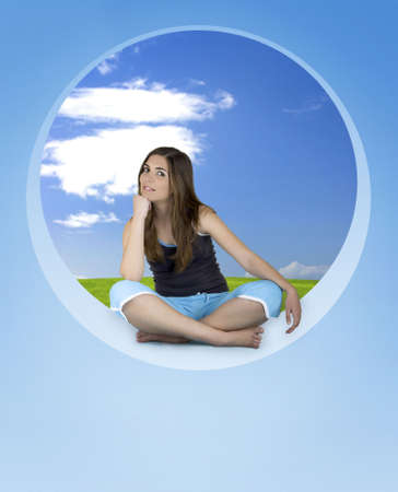 Beautiful Athletic woman seated and relaxing on a blue round window photo