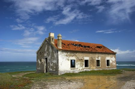 Beautiful scene of an old abandoned house close to the coast