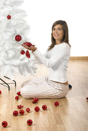 home decorating: Happy woman on her home decorating a Christmas tree Stock Photo