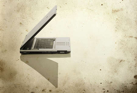 msn: Picture of a laptop on a white background with a grunge background   Stock Photo