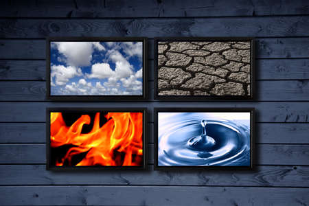 Big panel of TV�s on a wood blue wall showing a presentation with the earth elements photo