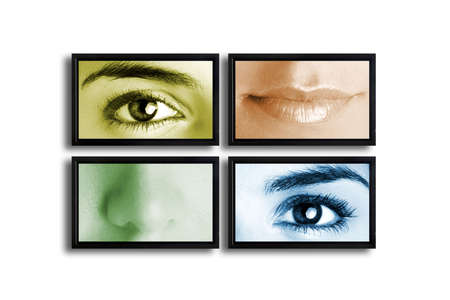 Four TV�s on a white wall showing a presentation with parts of the female face photo