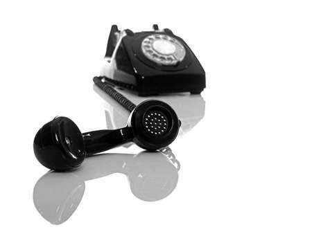device disc: Vintage phone on a white background with reflection