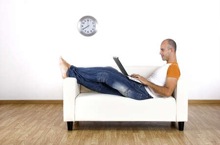 workplace wellness: Man working at home with the laptop