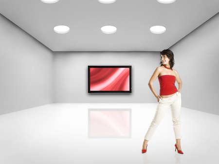 Beautiful woman on big room with a big TV  photo