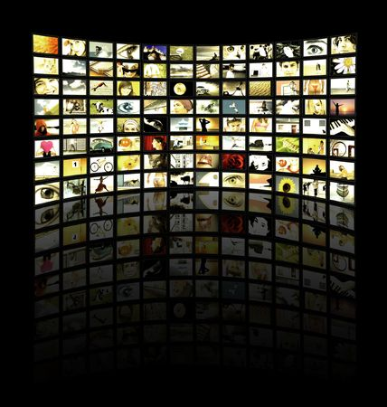 Big panel of TV�s showing movies
