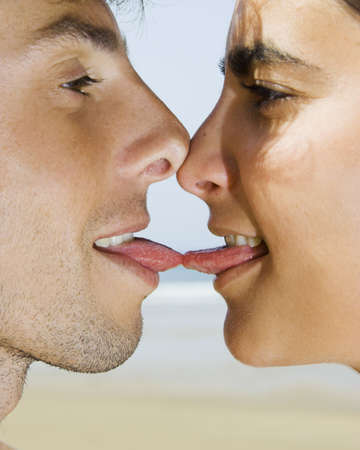 passionate kissing: Portait of a young couple giving a tongue kiss Stock Photo