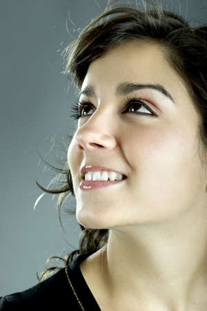 teenagers laughing: A close-up portrait of a beautiful young and attractive woman