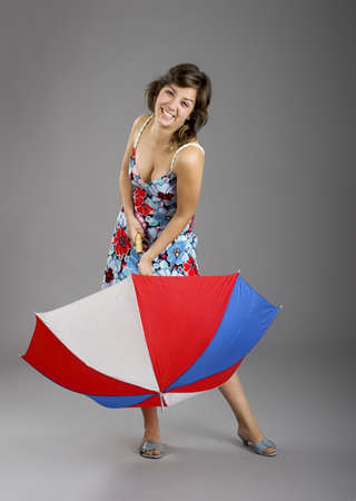 Portrait of a young happy woman posing with an umbrella photo