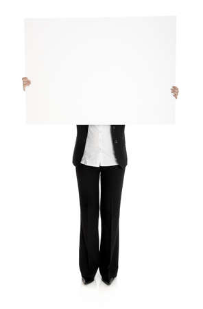 Portrait of a woman holding a blank billboard in front of her photo