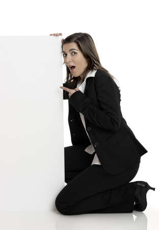 Portrait of a beautiful surprised woman holding a blank billboard Stock Photo - 2510662