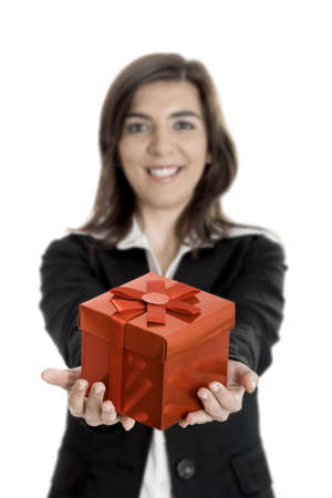 bussiness: Beautiful bussiness woman holding a gift isolated on white