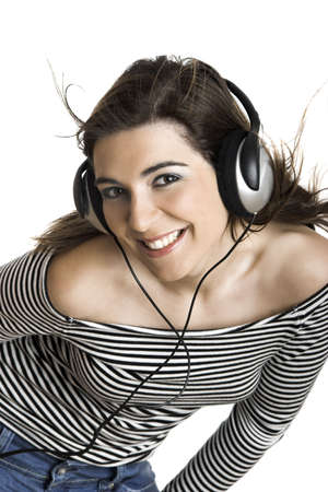 Beautiful young woman listening music with headphones isolated on white backgroun Stock Photo