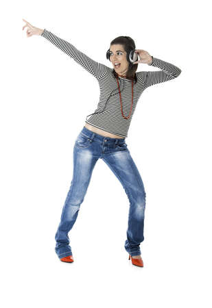 Beautiful young woman listening music with headphones isolated on white backgroun photo