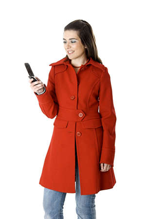 Beautiful young woman with a red coat holding a cellphone photo