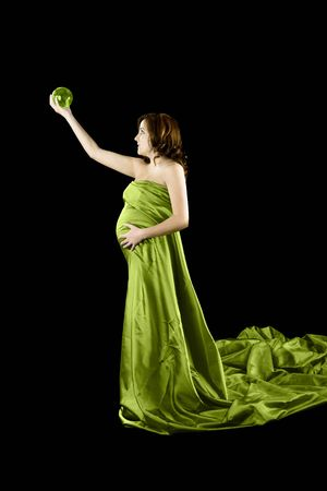 Beautiful Pregnant woman holding a Crystal Ball with a beautiful dress photo