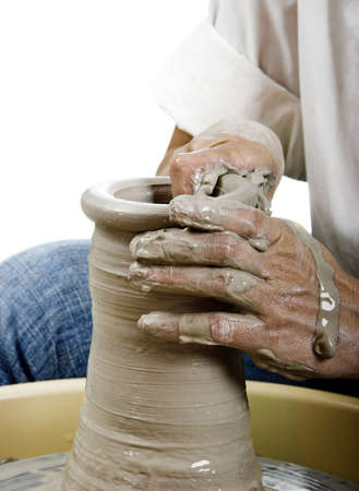potters wheel: Close-up picture of a potter works a potters wheel
