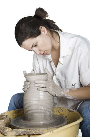 potters wheel: Picture of a potter works a potters wheel Stock Photo
